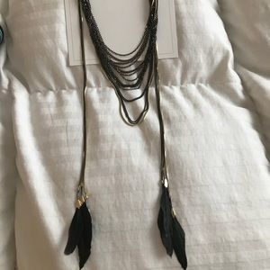 Black and gold necklace with feathers
